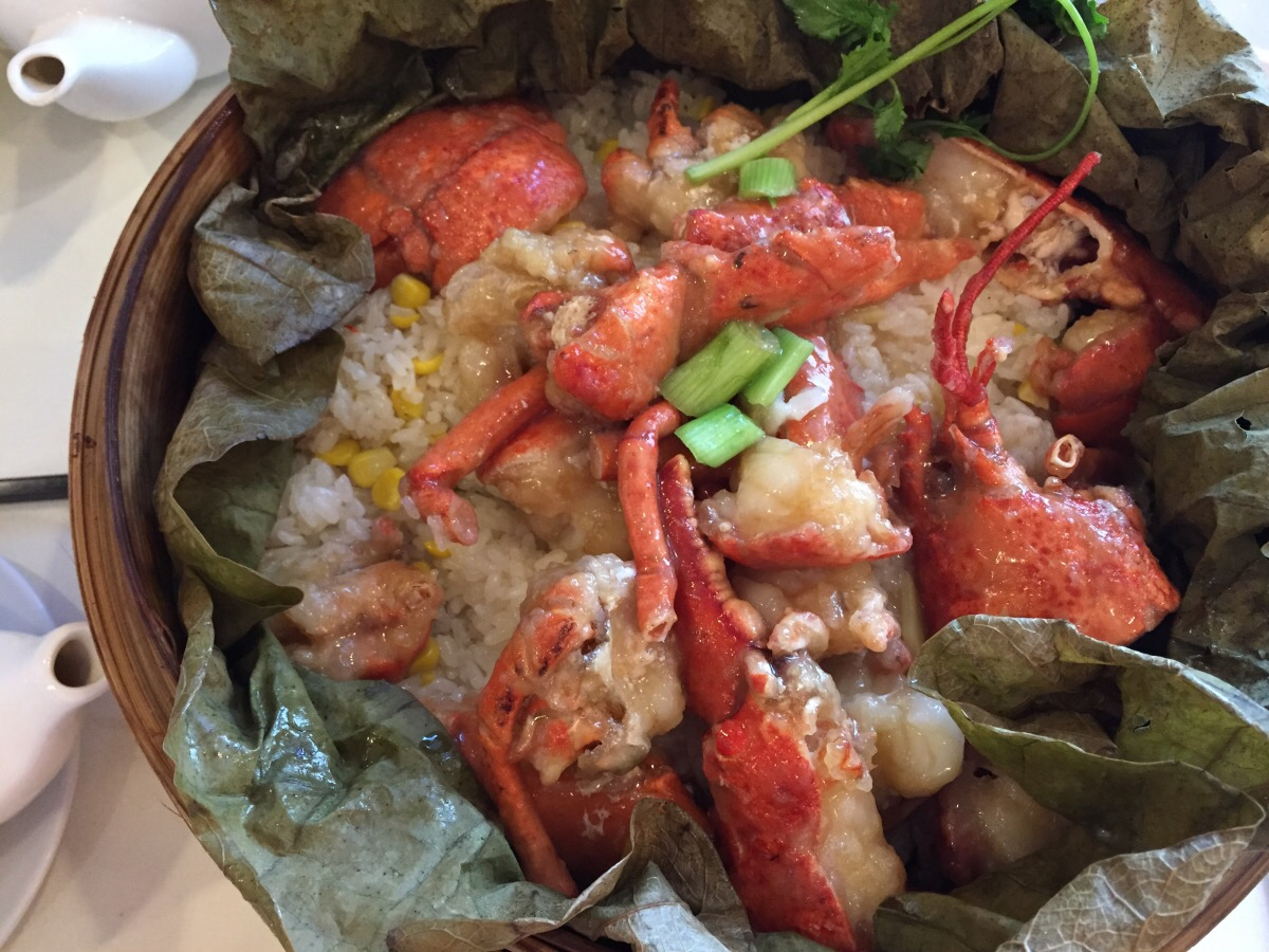 Lobster Steamed with Sticky Rice on Lotus Leaf