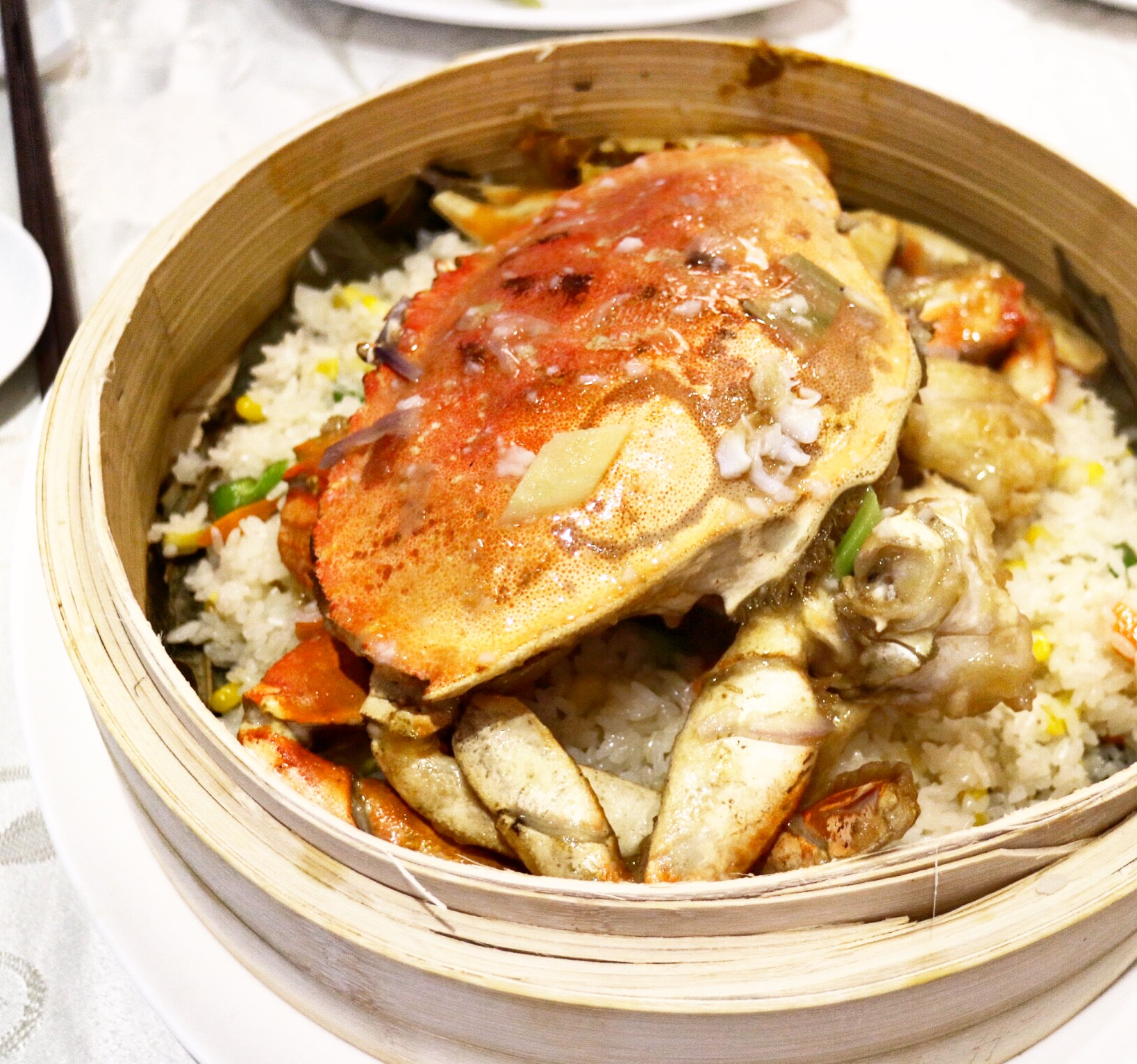 steamed dungeness crab with sticky rice on lotus leaf