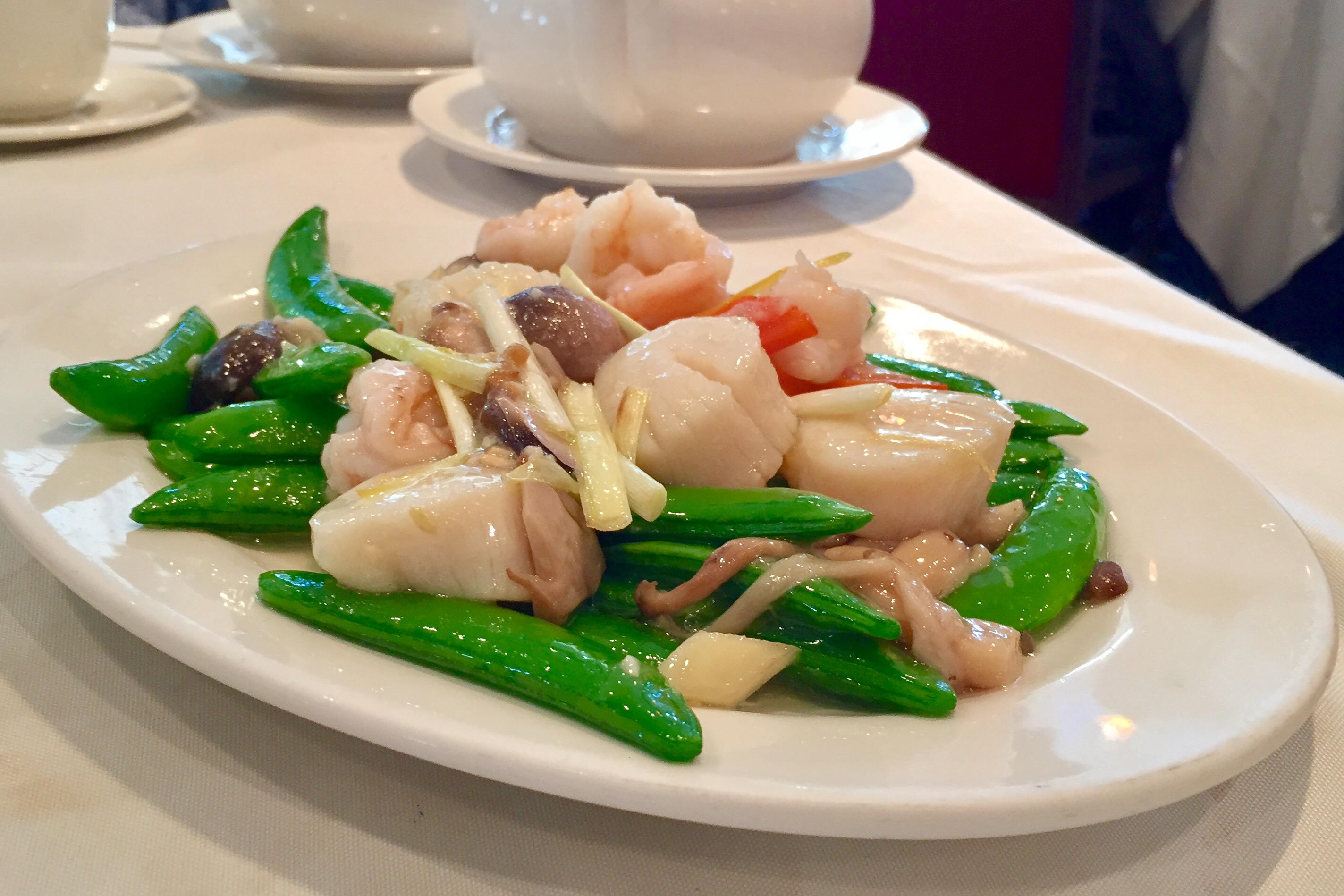 Scallop and Prawn Sautéed with Snap Peas and Assorted Mushrooms