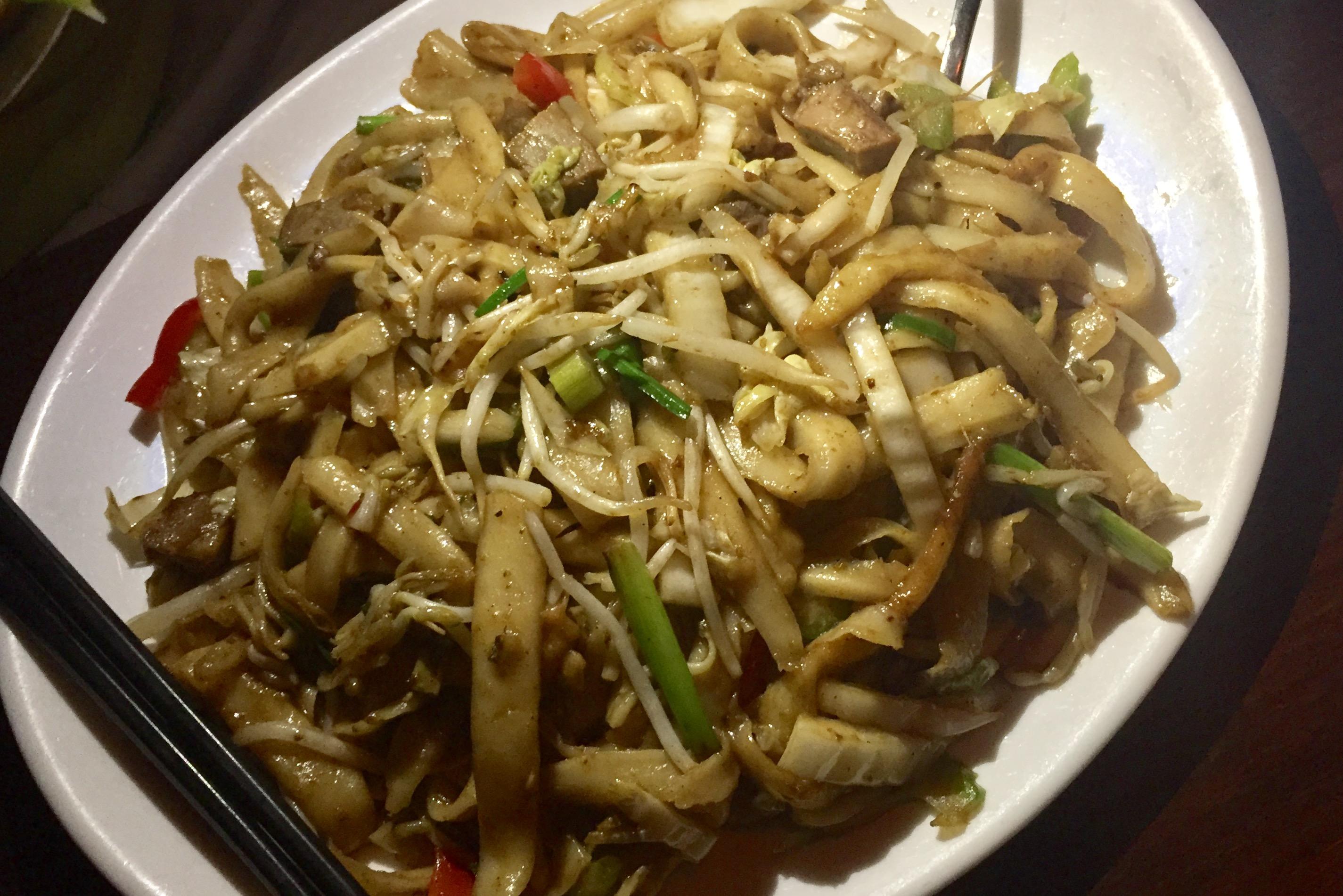 Stir fried sliced noodles with tofu and egg