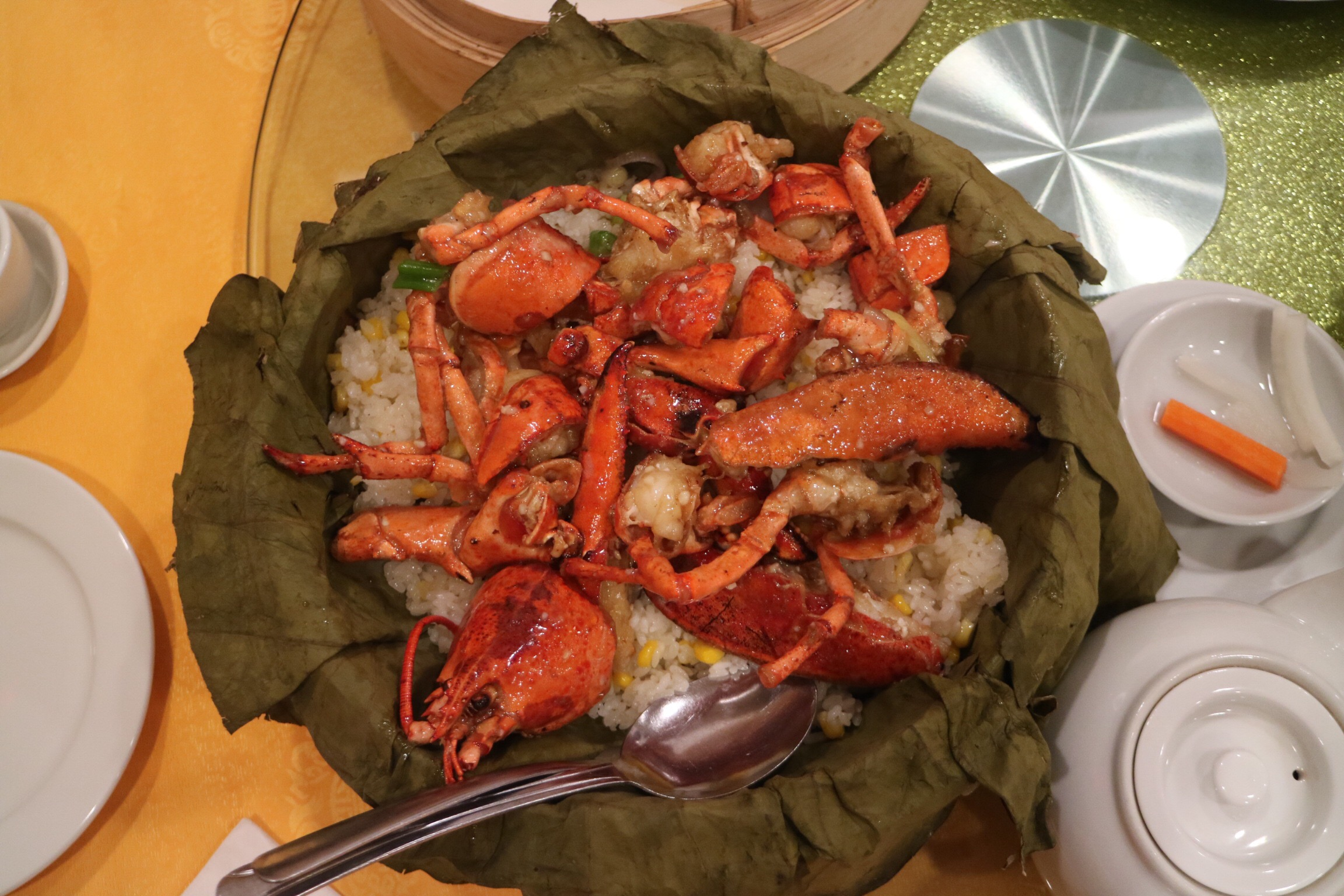 whole lobster and sticky rice on lotus leaf