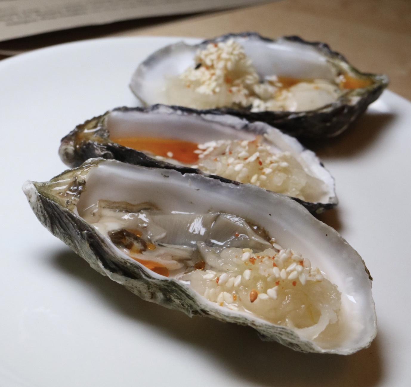 hog island sweetwater oysters with kohlrabi kraut & sesame