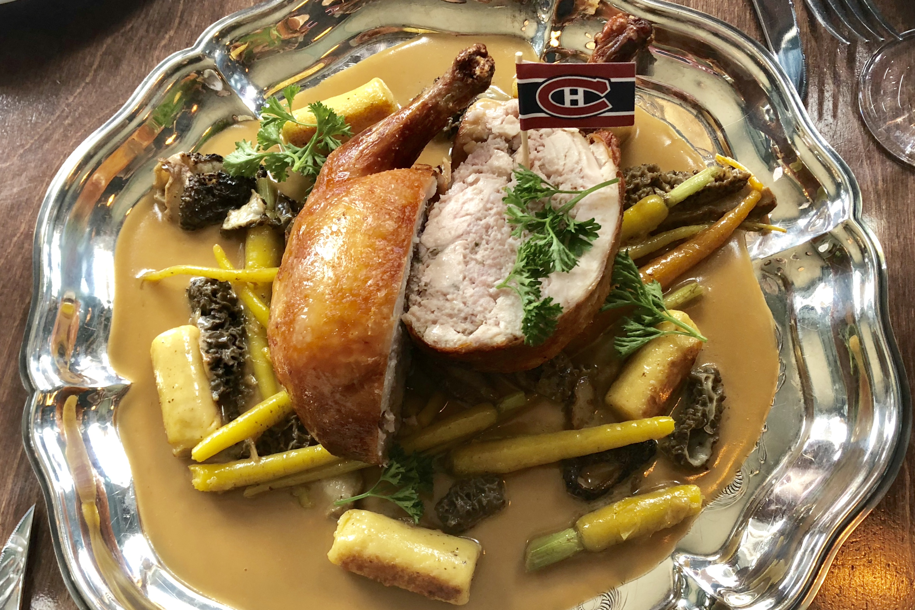 Cournouaille, stuffed Cornish hen with sweet bread, served with gnocchi and morels