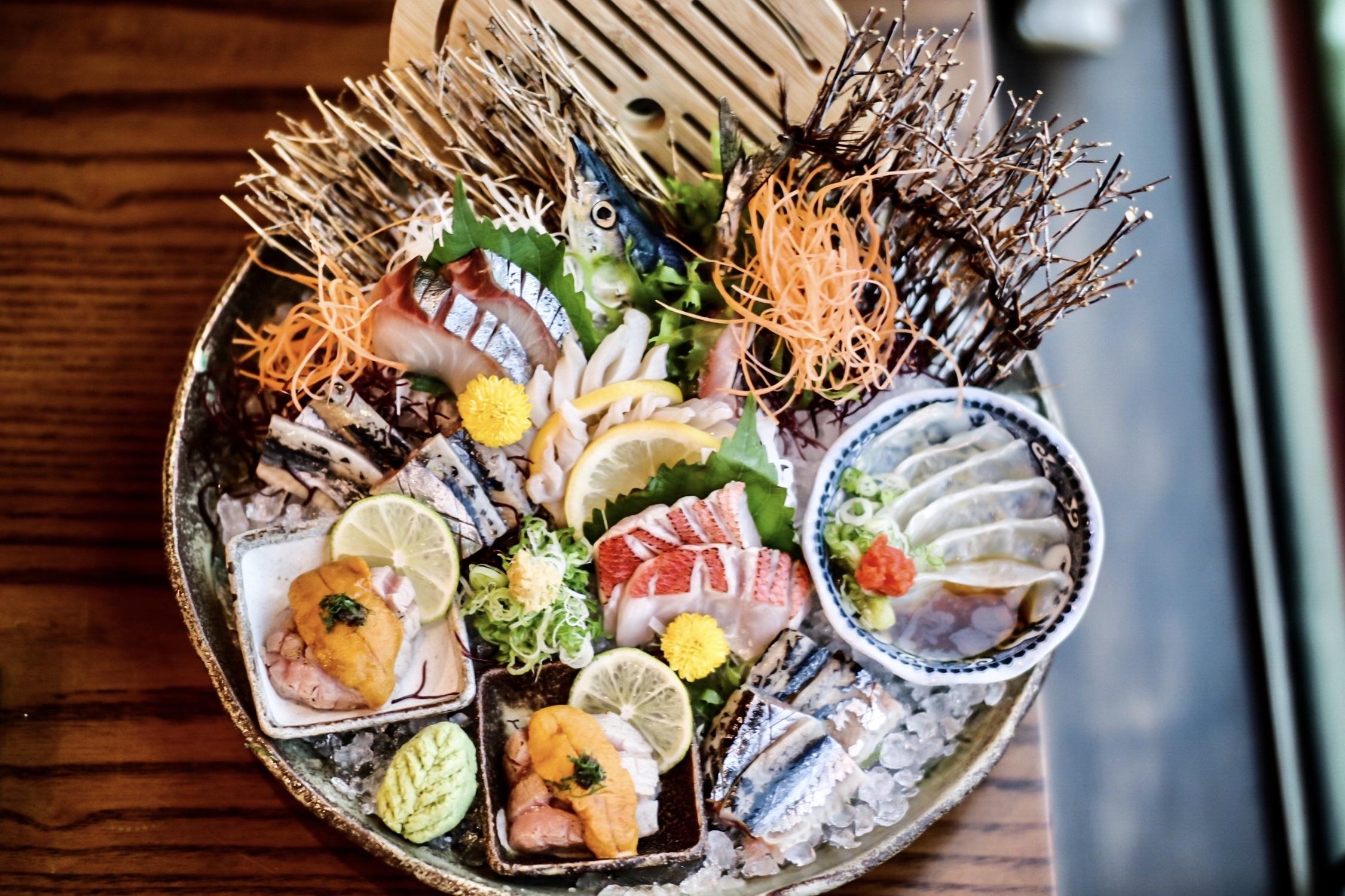 from top left, clockwise: ma-aji, mirugai, hirame, shima aji, o-toro + uni + truffle + kinmedai
